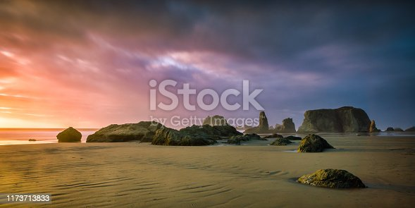 Dramatic and colorful sunset at Bandon Beach in Oregon. A dissipated storm brought a dramatic sky.