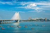 istock Bandra - Worli Sea Link bridge with fishing boats view from Bandra fort. Mumbai, India 1224015052