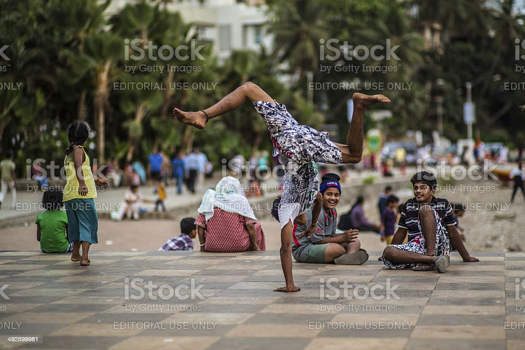 Bandra_breakdance Mumbai, India - May 21, 2013: Guy preforming breakdance in the afternoon at a open space in Bandra, Mumbai Active Lifestyle Stock Photo