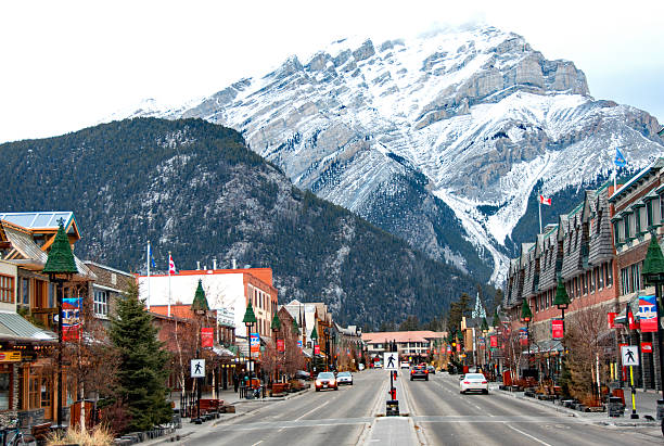 banff avenue retail area in  banff, alberta- winter - banff national park stock photos and pictures