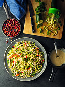 Home made freshness courgette noodles with bang bang chicken salad with tahini peanuts dressing