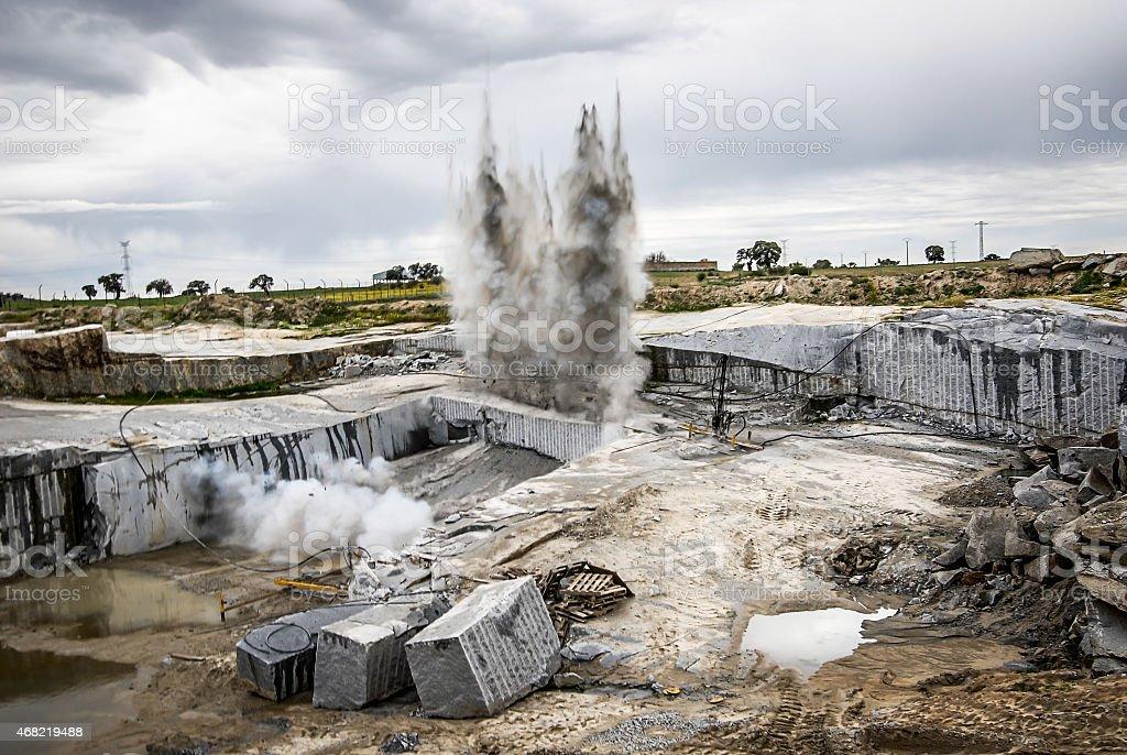bang for the extracion granite quarry opencast stock photo