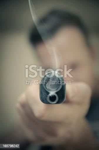 Man with smoking gun