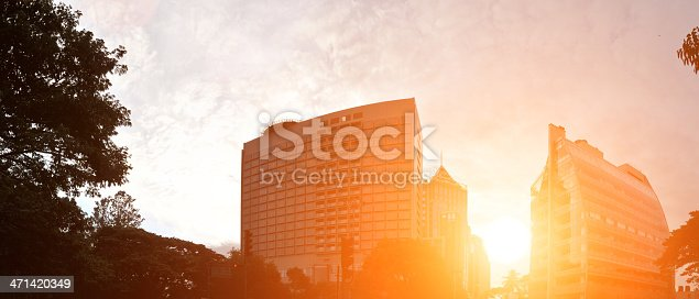 Bangalore or bengluru city scape with sun ricing  in the middle of building creates lens flare effects