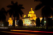 istock Bangalore lit up at night with palm trees 119474731