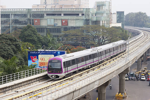 Bangalore Metro, India Bangalore, India - December 1, 2011: A train of the Bangalore Metro Rail, a rapid transit rail system, moves along an elevated track in downtown Bangalore, India. A section of the first phase of the Metro opened to the public in October 2011. bangalore stock pictures, royalty-free photos & images