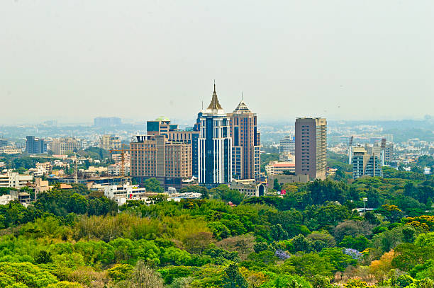 Bangalore or bengalurucity scape with green trees on foreground Bangalore city scape with trees in foreground bangalore stock pictures, royalty-free photos & images