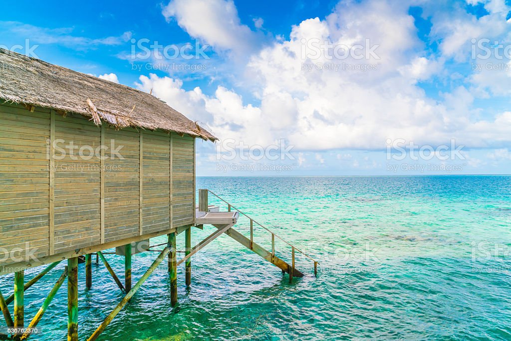 Bangalow with stairs into the sea in Maldives stock photo