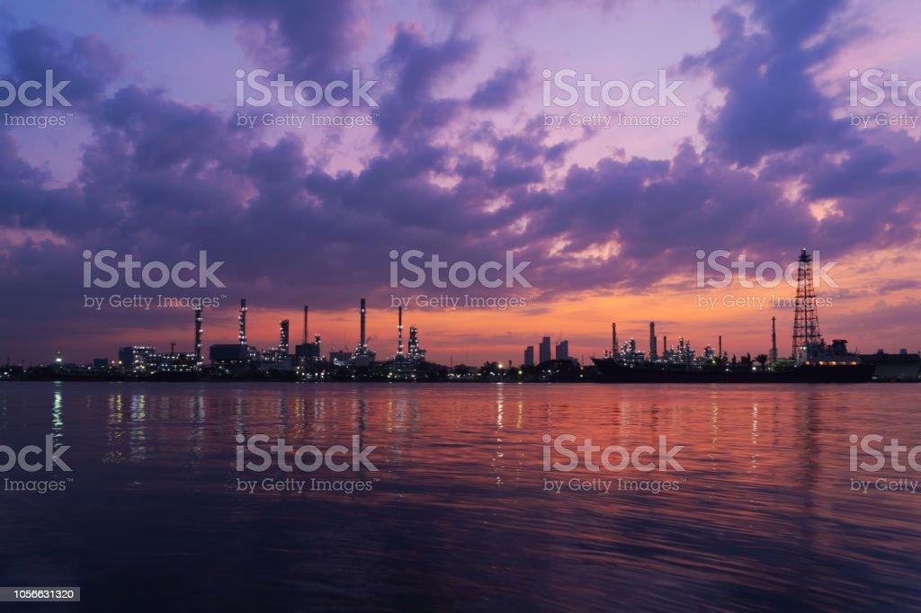 Bangchak Petroleum\'s oil refinery at sunrise in industrial...