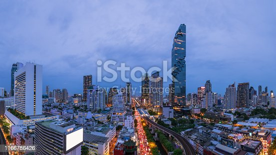 Bangkok business district cityscape with skyscraper at twilight, Thailand