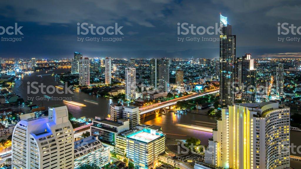Bangkok city - Beautiful sunset curve Chao Phraya River Cityscape urban  of Bangkok city at night  , panorama landscape Thailand stock photo