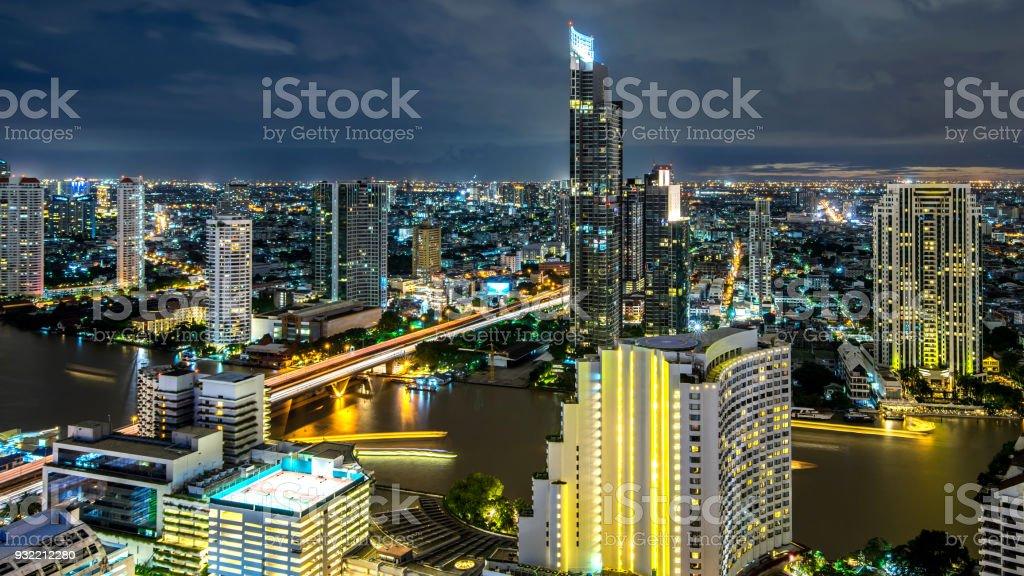 Bangkok city - Beautiful sunset curve Chao Phraya River long exposure light Cityscape urban  of Bangkok city at night  , panorama landscape Thailand stock photo