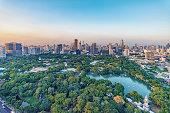 Lumphini Park and skyscrapers in Bangkok city, Thailand