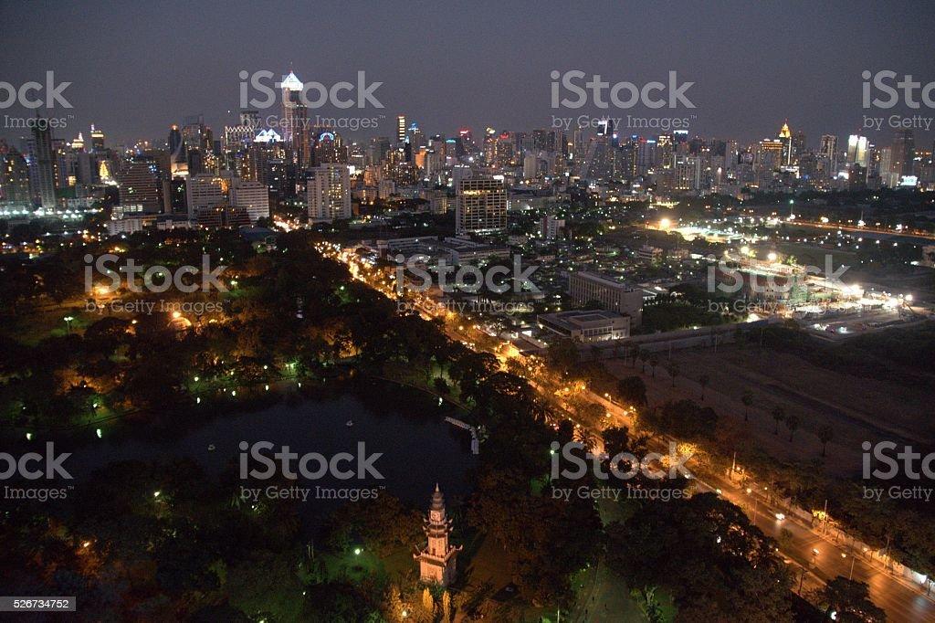 Bangkok cityscape and Lumpini Park by night, Thailand stock photo