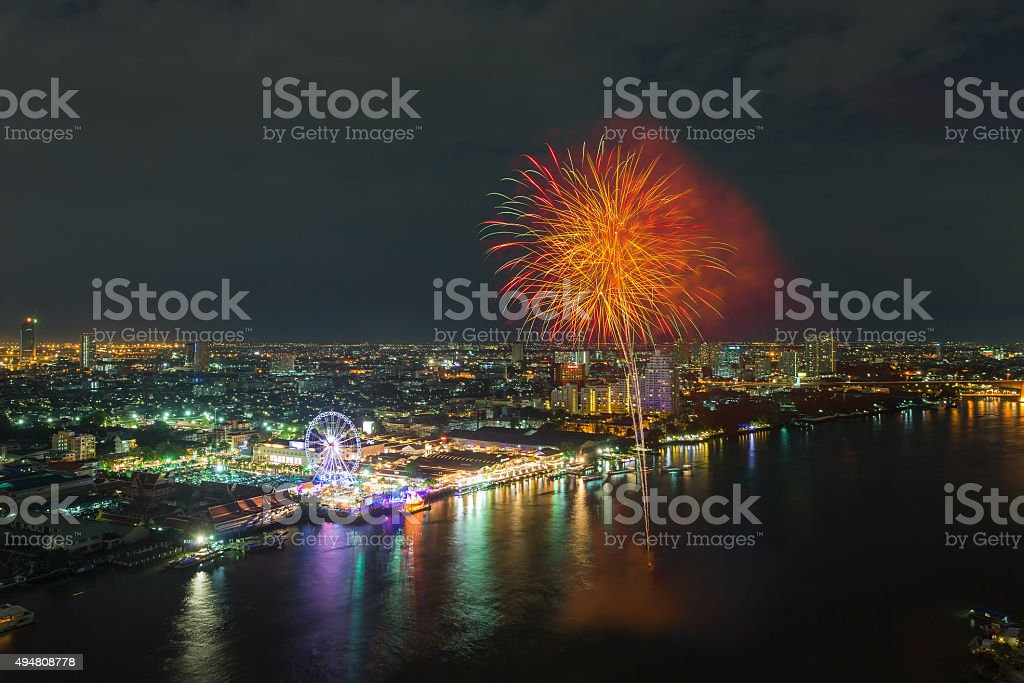 Bangkok cityscape river view with Fireworks at night scene stock photo