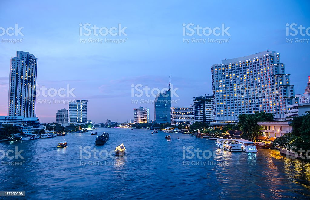Bangkok Cityscape With River And Boat At Night Time Stock