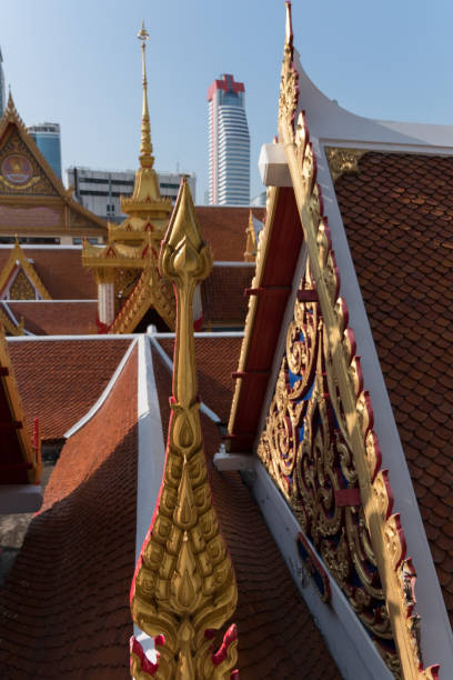 Bangkok contrasting roofs with spear stock photo