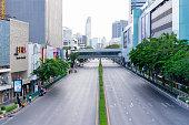Bangkok, Thailand-Apirl 12: Few of cars on Phayathai road during outbreak of Covid-19 on April 12,2020 at Pathum Wan intersection, Bangkok, Thailand.