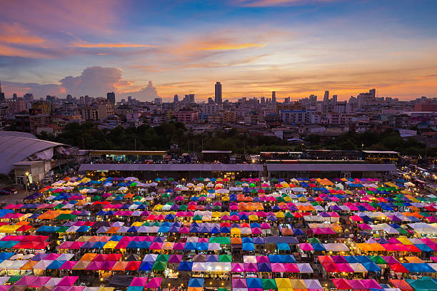 Bangkok Flea market aerial view Bangkok Flea market aerial view with beauty of sunset night market stock pictures, royalty-free photos & images