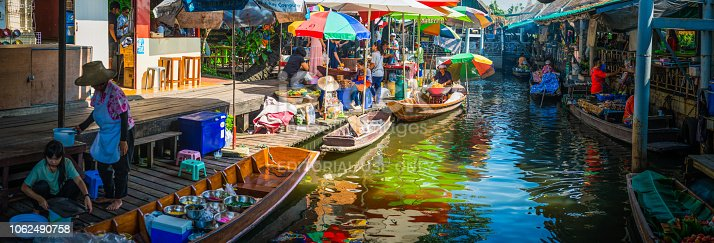 Local farmers and traders selling food and produce at a colourful floating market in Bangkok, Thailand's vibrant capital city.