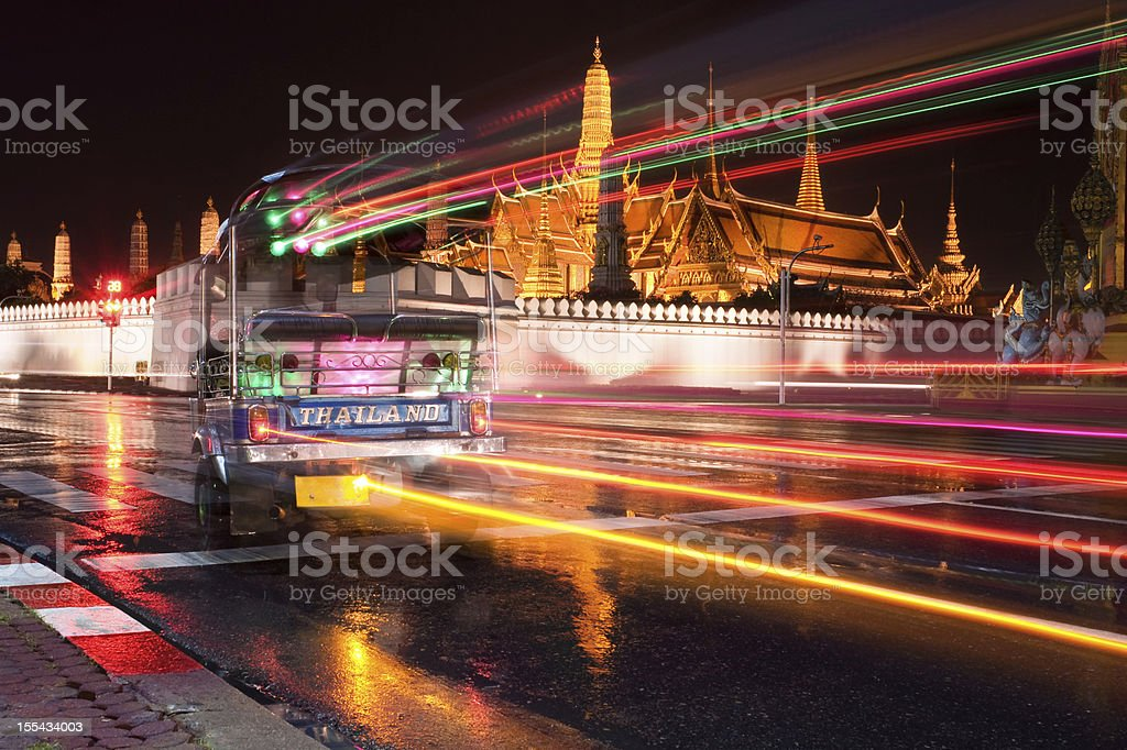 Bangkok Night Traffic - Tuk-Tuk in front of Grand Palace royalty-free stock photo