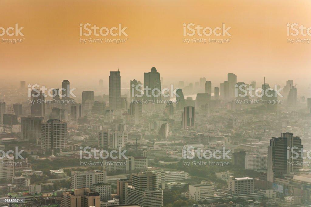 Bangkok skyline in smog during sunset stock photo