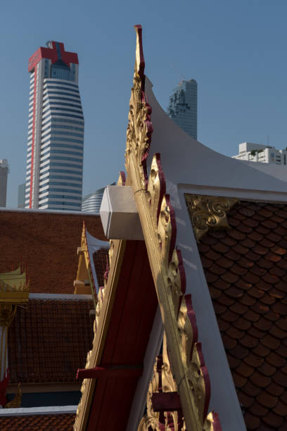 Bangkok temple roof and skyscaper stock photo