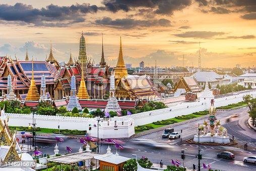 Bangkok, Thailand at the Temple of the Emerald Buddha and Grand Palace at dusk.