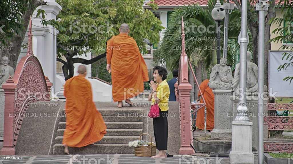 Bangkok, Thailand December 5, 2017: In the morning , People give food offerings to Buddhist monks  At Wat Benchamat, Bangkok, Thailand stock photo
