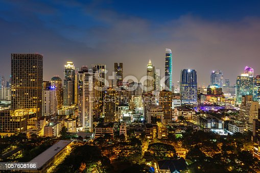 Illuminated modern skyscraper cityscape in downtown Bangkok at twilight - night. Pathum Wan, Bangkok, Thailand, Asia