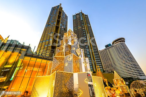 istock Bangkok,Thailand on November 23,2019:Large Christmas trees to celebrate Christmas and New Year Festival at River Park of ICONSIAM,the new shopping complex on the riverbank of Chao Phraya River. 1189913412
