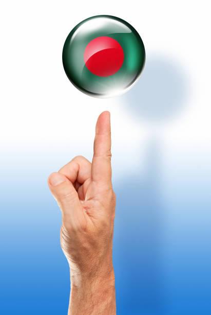 Bangladesh button flag pointing with human hand stock photo
