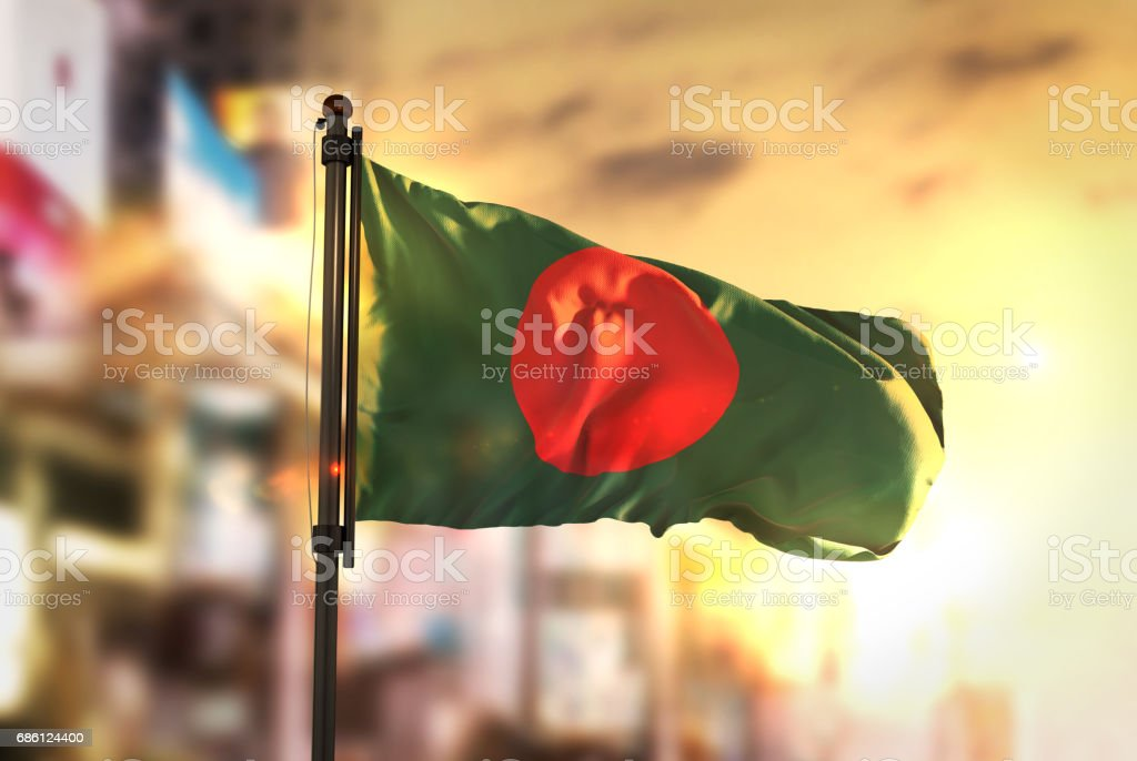 Bangladesh Flag Against City Blurred Background At Sunrise Backlight stock photo
