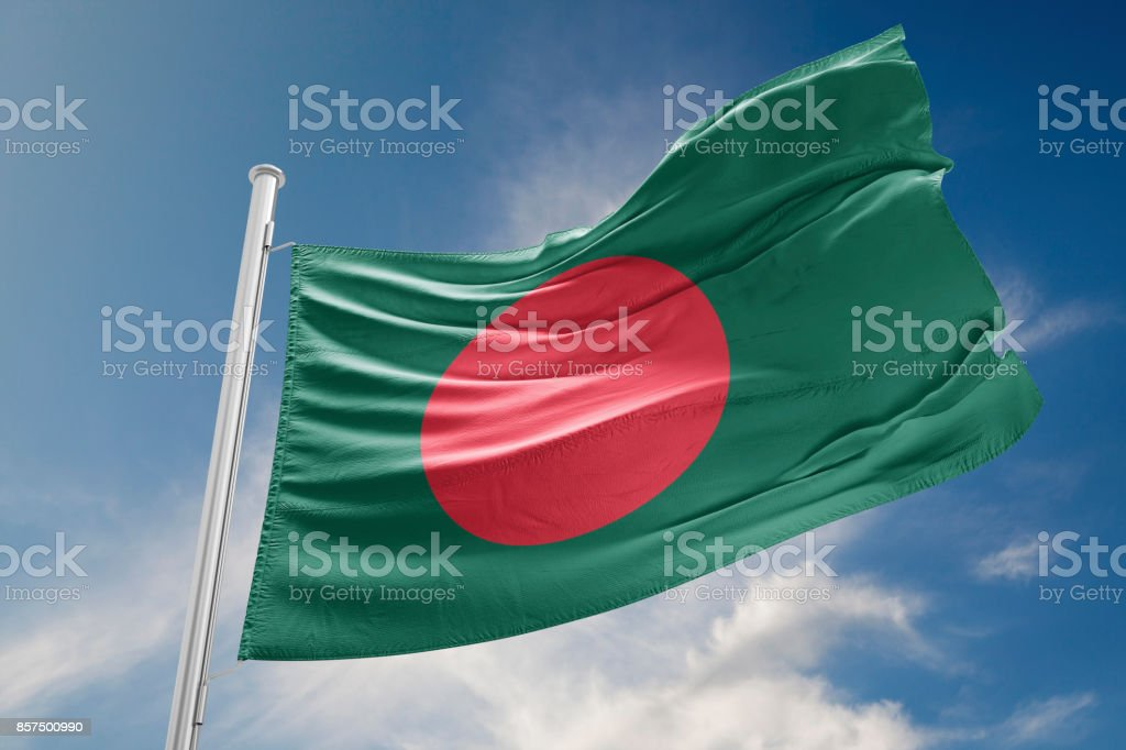 Bangladesh Flag is Waving Against Blue Sky stock photo