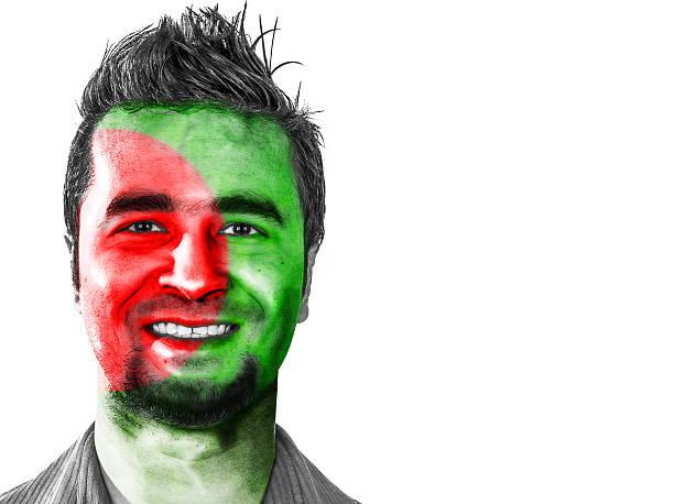 Bangladesh flag on a male face stock photo