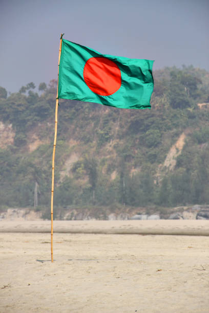 Bangladesh Flag Waving on a Blue Sky With Hill Background stock photo