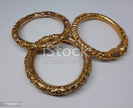 This is an image of beautiful gold bangles.