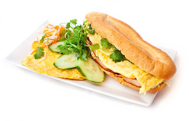 Banh mi bacon egg Banh mi ¬ vietnamese baguettes sandwiches  on white background. Banh mi - white baguettes prepared with eggs. Decorated with fresh coriander. bánh mì sandwich stock pictures, royalty-free photos & images