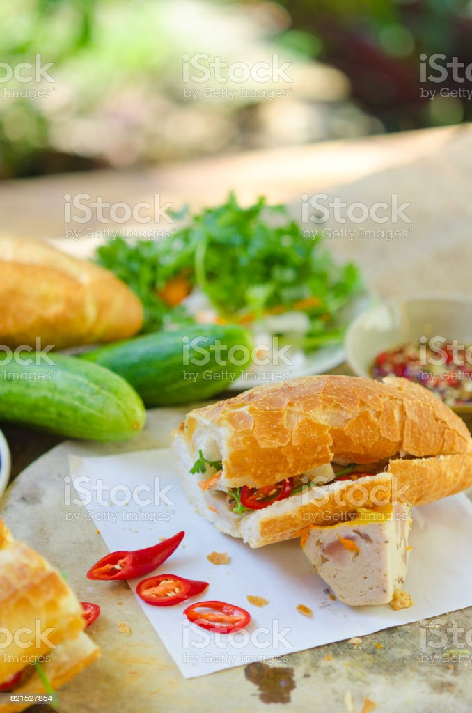 Banh Mi Cha Ca - A kind of Vietnamese sandwich with grilled fish and fresh vegetables. It's really popular in the central of Vietnam stock photo