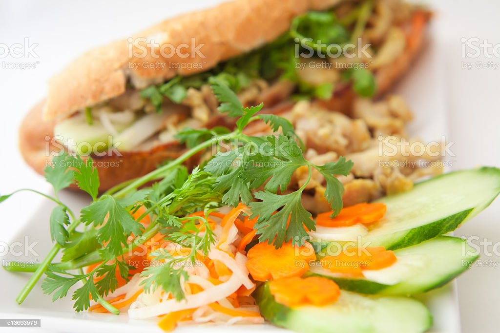 Banh mi -  vietnamese baguette with pork bacon and chicken stock photo