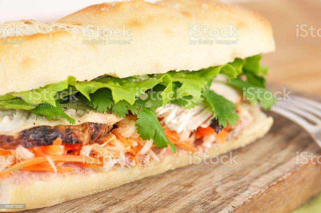 Banh Mi Vietnamese Sandwich on Cutting Board stock photo