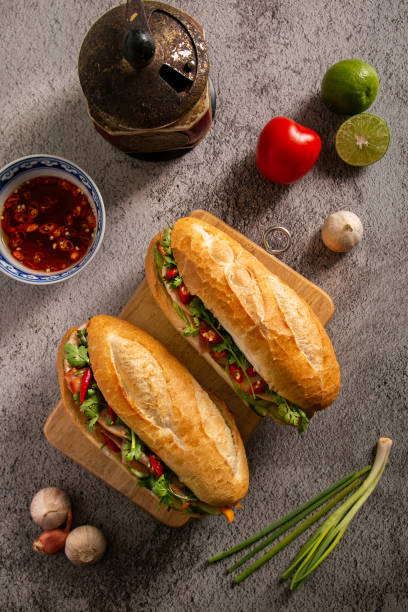 Banh Mi - Vietnamese sandwich Banh Mi - Vietnamese sandwich, one of the most famous food in the world bánh mì sandwich stock pictures, royalty-free photos & images