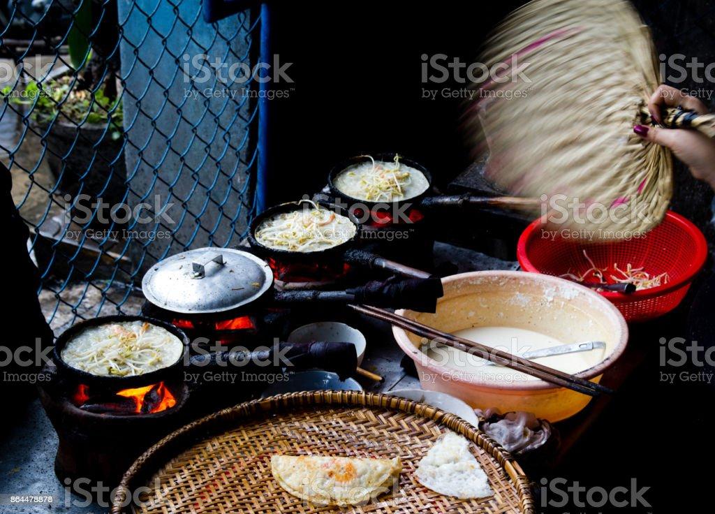 Banh xeo- Vietnamese crepe Vietnamese crepe in the poor area of vietnam Asia Stock Photo