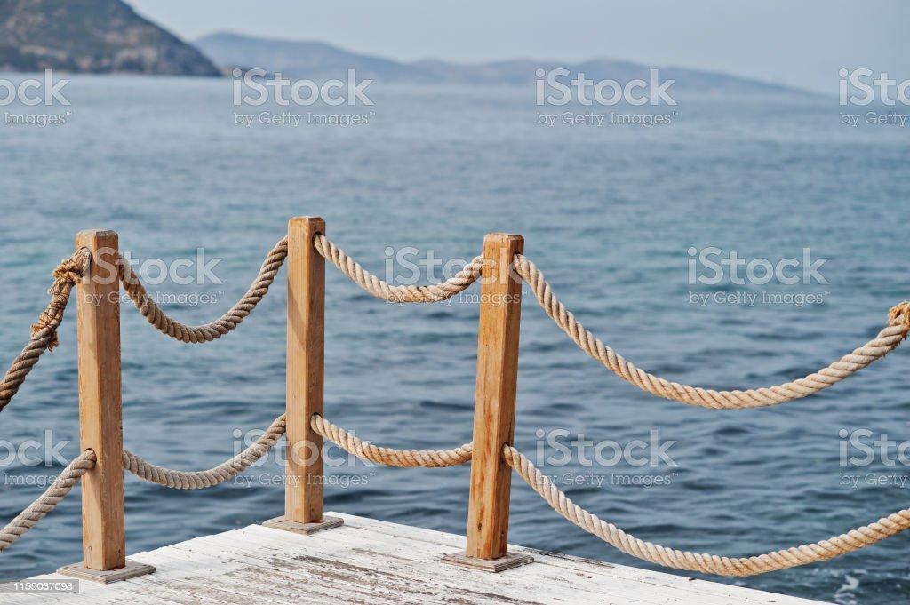 Banister railing on marine rope and wood Turkey Mediterranean sea.
