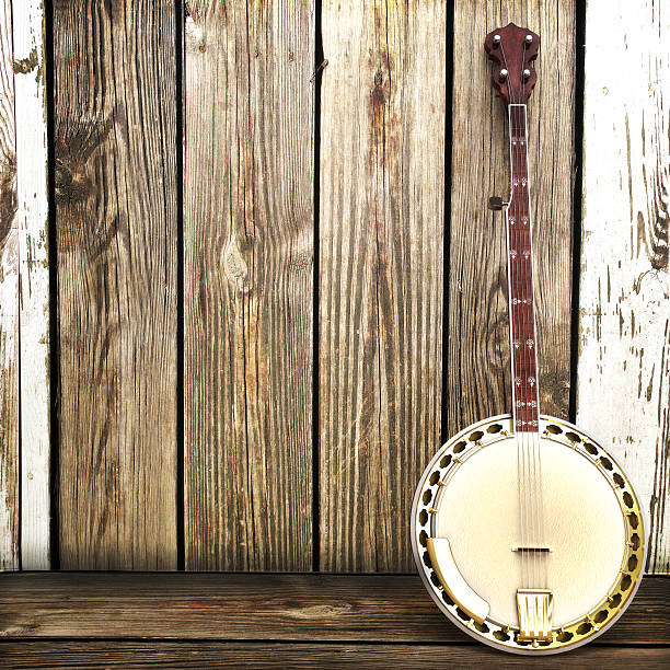 Banjo leaning on a wooden fence  Advertisement with room for text or copy space.  folk music stock pictures, royalty-free photos & images