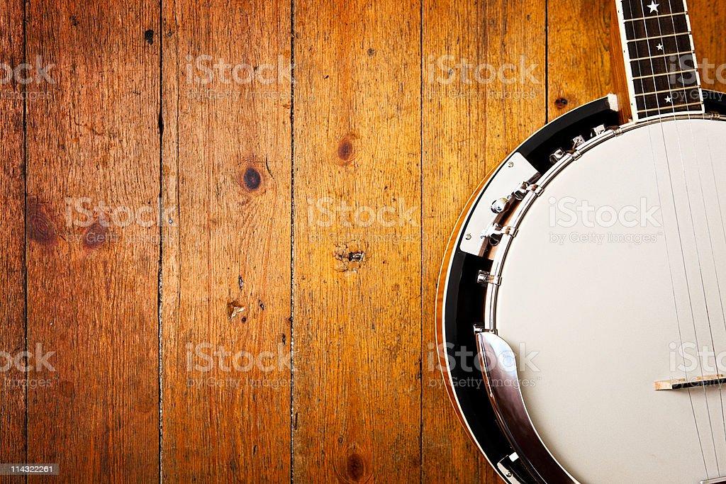Banjo em fundo de madeira - foto de acervo