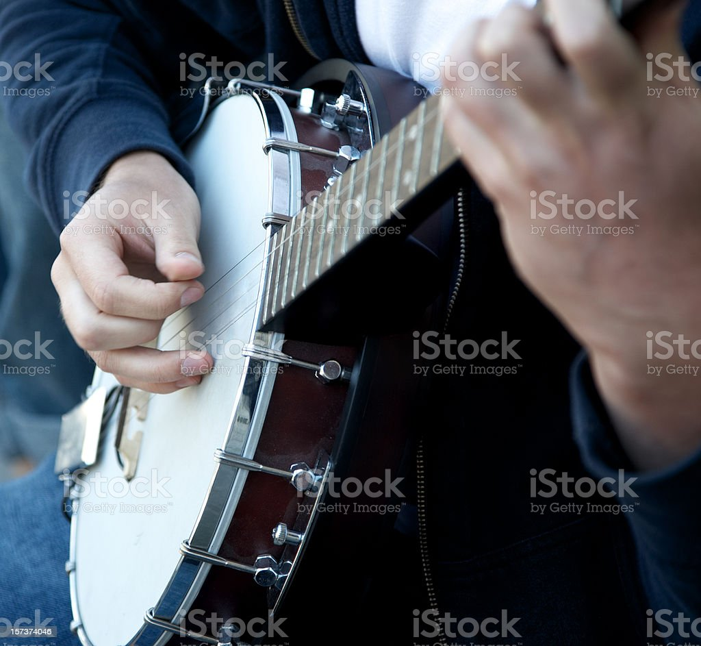 Banjo player hands close shot stock photo