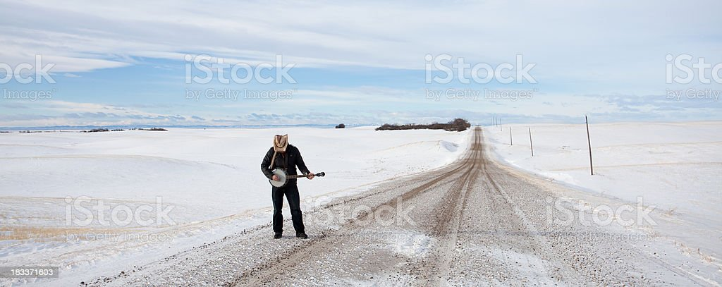 Banjo Player on a Country Road stock photo