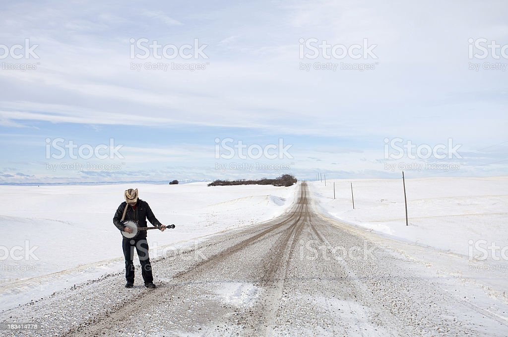 Banjo Player on a Rural Road stock photo