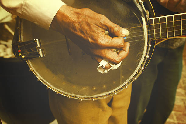 Banjo player A man with bandaged finger plays the banjo folk music stock pictures, royalty-free photos & images